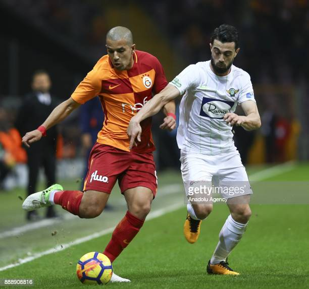 Feghouli of Galatasaray in action against Aykut Ceviker of Teleset Mobilya Akhisarspor during the Turkish Super Lig match between Galatasaray and...