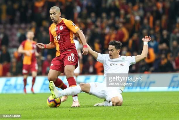 Feghouli of Galatasaray in action against Ferhat Oztorun of Atiker Konyaspor during a Turkish Super Lig soccer match between Galatasaray and Atiker...