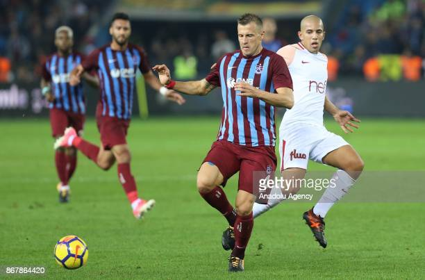 Feghouli of Galatasaray in action against Jan Durica of Trabzonspor during a Turkish Super Lig match between Trabzonspor and Galatasaray at Medical...
