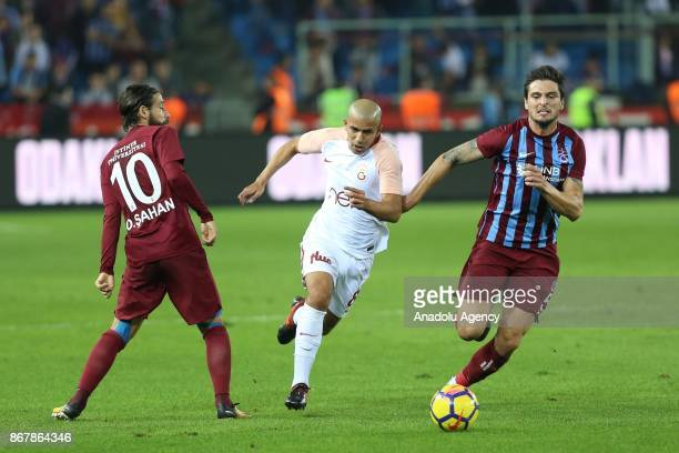 Feghouli of Galatasaray in action against Okay Yokuslu and Olcay Sahan of Trabzonspor during a Turkish Super Lig match between Trabzonspor and...