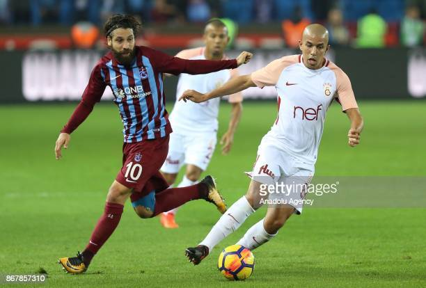 Feghouli of Galatasaray in action against Olcay Sahan of Trabzonspor during a Turkish Super Lig match between Trabzonspor and Galatasaray at Medical...