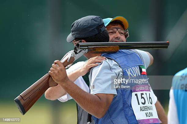 Fehaid Aldeehani of Kuwait celebrates winning a Bronze medal shootoff against Michael Diamond of Australia in the Men's Trap Shooting Final on Day 10...