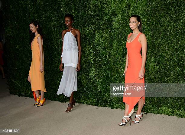 Fei Fei Sun, Maria Borges, and Emily DiDonato attend the 12th annual CFDA/Vogue Fashion Fund Awards at Spring Studios on November 2, 2015 in New York...