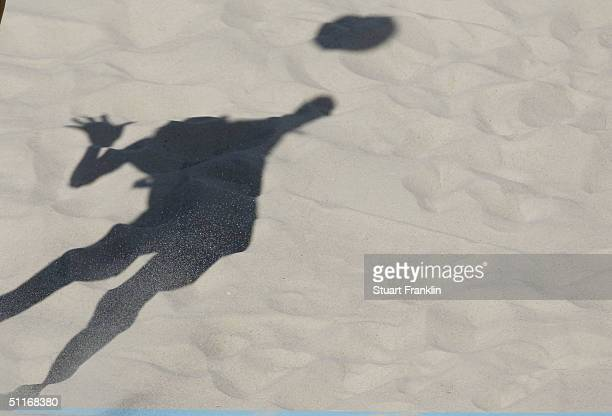 Fei Wang of China serves the ball in the women's preliminary match on August 14, 2004 during the Athens 2004 Summer Olympic Games at the Olympic...