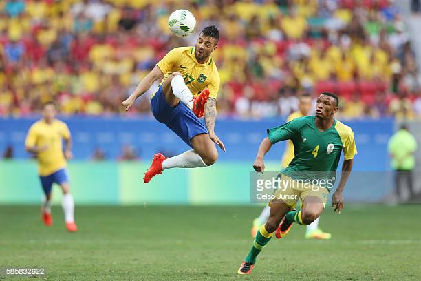 Feipe Anderson of Brazil leaps to control the ball against Mothobi Mvala of South Africa at Mane Garrincha Stadium on August 4 2016 in Brasilia Brazil
