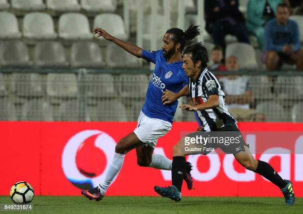 Feirense defender Bruno Nascimento from Brazil with Portimonense SC forward Shoya Nakajima from Japan in action during the Portuguese Primeira Liga...