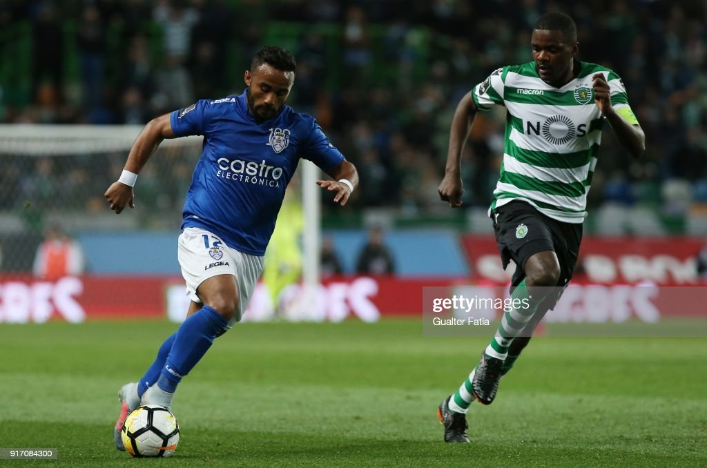CD Feirense forward Edson Farias from Brazil with Sporting CP midfielder William Carvalho from Portugal in action during the Primeira Liga match between Sporting CP and CD Feirense at Estadio Jose Alvalade on February 11, 2018 in Lisbon, Portugal.