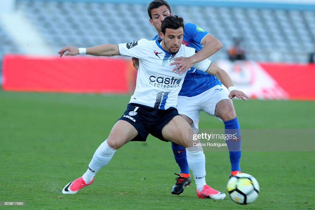 Feirense forward Luis Machado from Portugal (F) vies with CF Os Belenenses defender Andre Geraldes from Portugal (B) for the ball possession during the Primeira Liga match between CF Os Belenenses and CD Feirense at Estadio do Restelo on February 24, 2017 in Lisbon, Portugal.