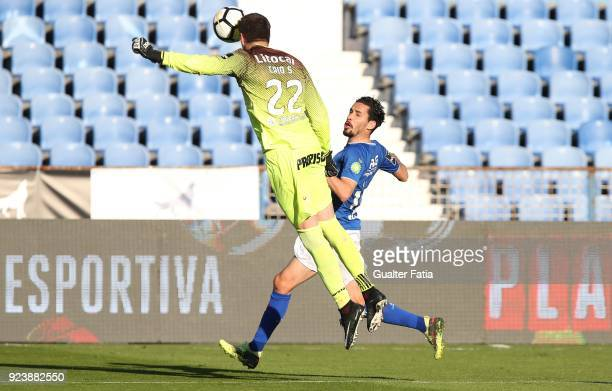 Feirense goalkeeper Caio Secco from Brazil with CF Os Belenenses forward Lica from Portugal in action during the Primeira Liga match between CF Os...