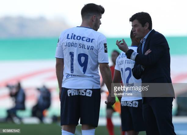 Feirense head coach Nuno Manta Santos from Portugal talks to CD Feirense forward Joao Silva from Portugal during the Primeira Liga match between CF...