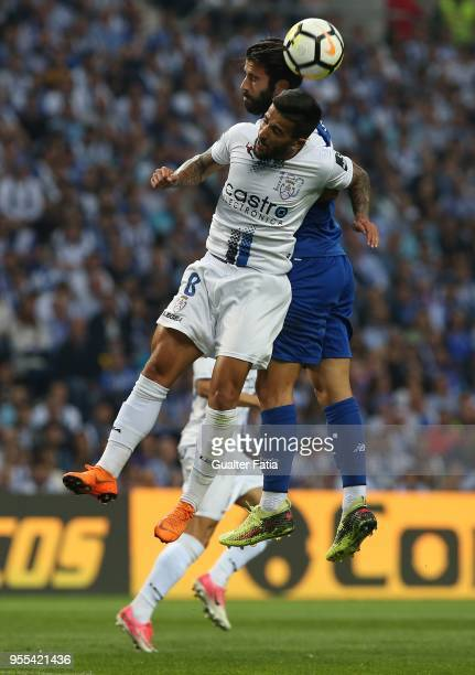 Feirense midfielder Tiago Silva from Portugal with FC Porto midfielder Sergio Oliveira from Portugal in action during the Primeira Liga match between...