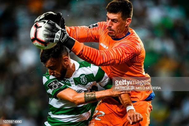 TOPSHOT Feirense's Brazilian goalkeeper Caio Secco stops a shot on goal by Sporting's Portuguese midfielder Bruno Fernandes during the Portuguese...
