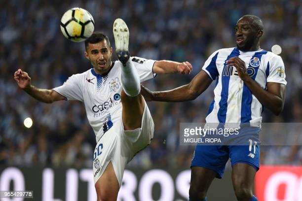 Feirense's Brazilian midfielder Rafael Crivellaro challenges Porto's Malian forward Moussa Marega during the Portuguese league football match between...
