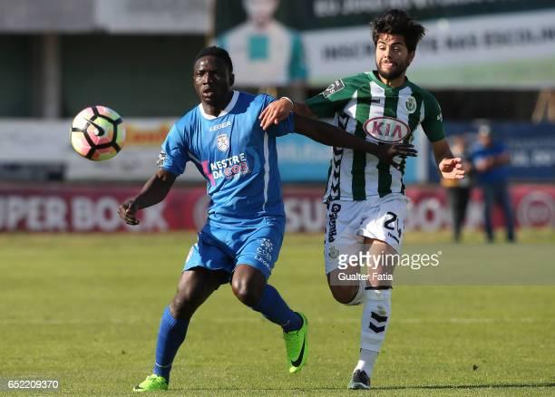 Feirense's forward Oghenekaro Etebo from Cape Verde with Vitoria de Setubal's forward Joao Amaral in action during the Primeira Liga match between...