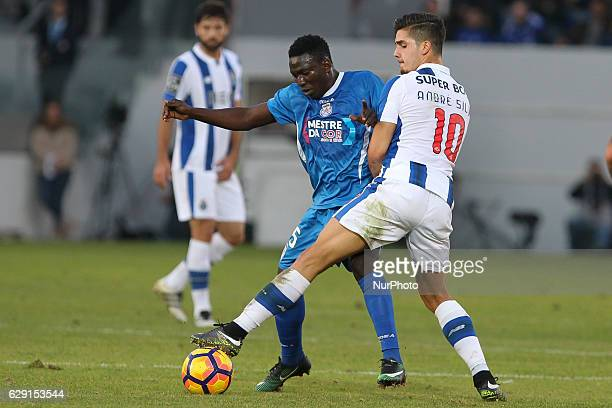 Feirense's forward Peter Etebo with Porto's Portuguese forward Andre Silva during the Premier League 2016/17 match between CD Feirense and FC Porto...