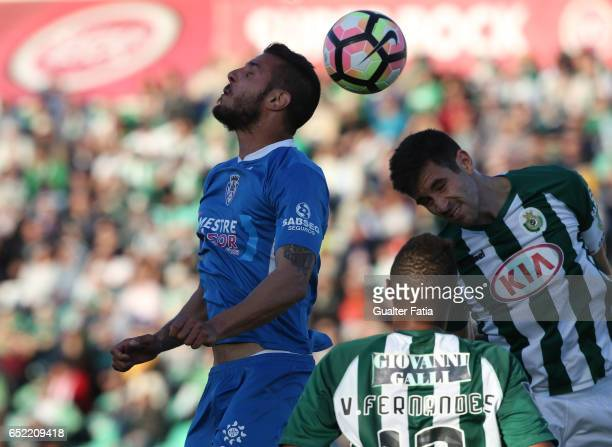 Feirense's forward Tasos Karamanos from Greece with Vitoria de Setubal's defender Frederico Venancio in action during the Primeira Liga match between...