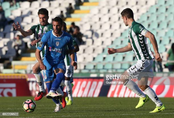 Feirense's forward Tasos Karamanos from Greece with Vitoria de Setubal's midfielder Nene Bonilha in action during the Primeira Liga match between...