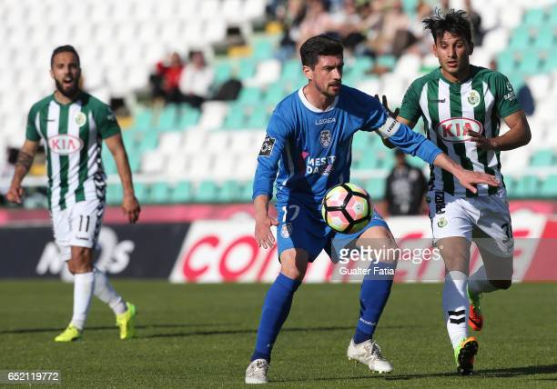 Feirense's midfielder Cris Santos from Portugal with Vitoria de Setubal midfielder Joao Carvalho in action during the Primeira Liga match between...