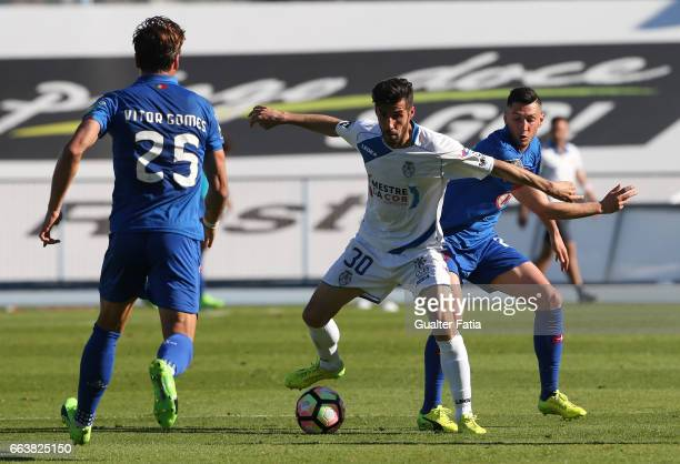 Feirense's midfielder Luis Aurelio from Portugal with Belenenses's defender Florent Hanin from France in action during the Primeira Liga match...