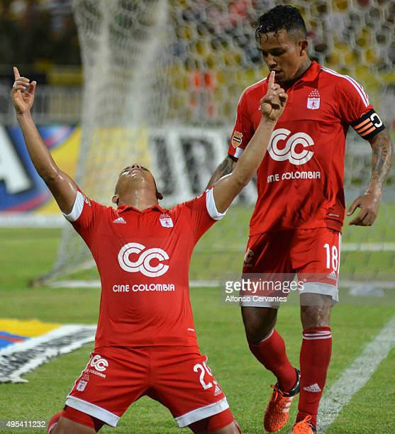 Feiver Mercado of America de Cali celebrates with his teammate Amilcar Henriquez after scoring the first goal of his team during a match between Real...