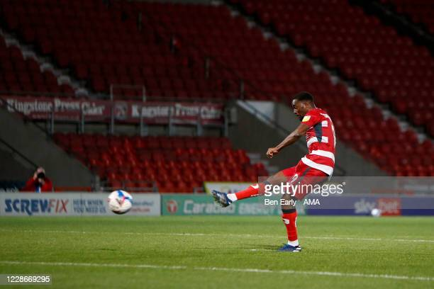 Fejiri Okenabirhie of Doncaster Rovers takes his penalty during the EFL Trophy match between Doncaster Rovers v Bradford City at Keepmoat Stadium on...