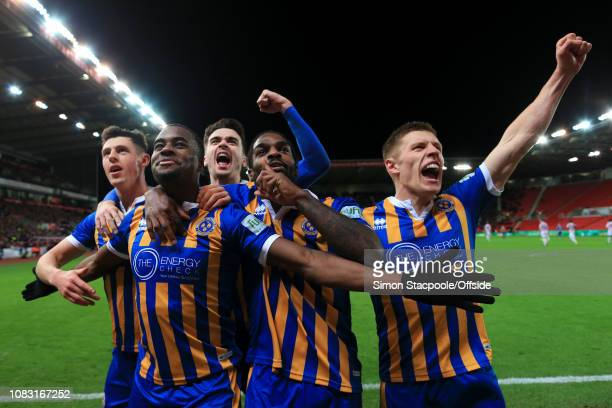 Fejiri Okenabirhie of Shrewsbury celebrates with teammates after scoring their 2nd goal during the FA Cup Third Round Replay match between Stoke City...