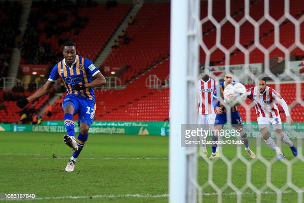 Fejiri Okenabirhie of Shrewsbury scores their 2nd goal with a penalty during the FA Cup Third Round Replay match between Stoke City and Shrewsbury...