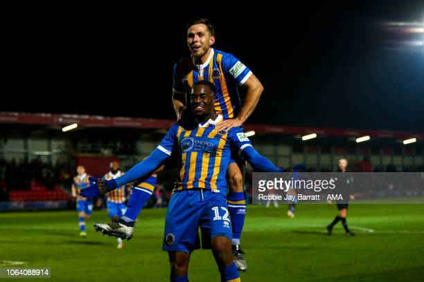 Fejiri Okenabirhie of Shrewsbury Town celebrates after scoring a goal to make it 13 during the Emirates FA Cup First Round Replay match between...