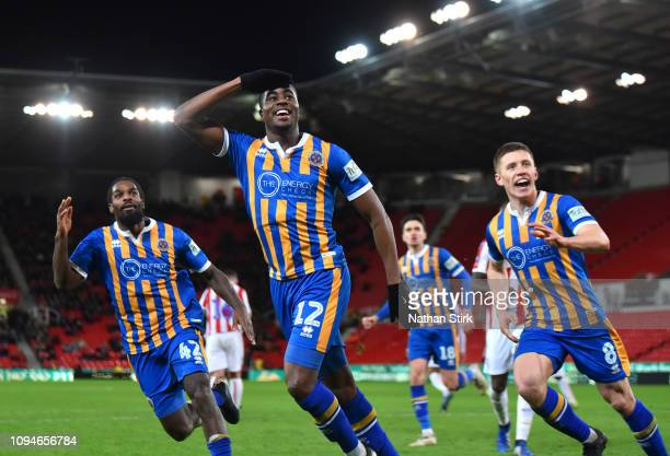 Fejiri Okenabirhie of Shrewsbury Town celebrates after scoring his sides second goal during the FA Cup Third Round Replay match between Stoke City...