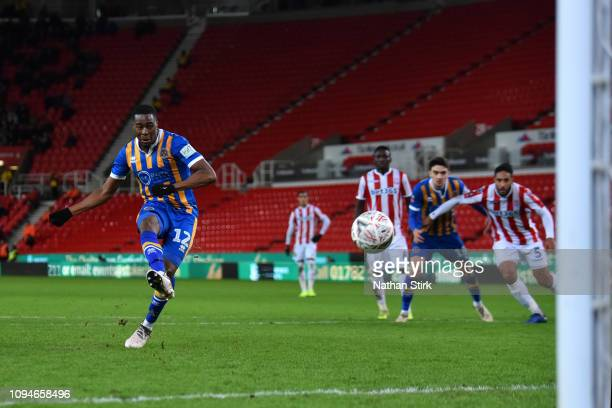 Fejiri Okenabirhie of Shrewsbury Town scores his sides second goal from the penalty spot during the FA Cup Third Round Replay match between Stoke...