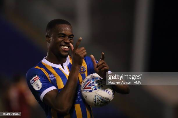 Fejiri Okenabirhie of Shrewsbury Town walks off with the match ball after scoring a hat trick during the EFL Checkatrade Trophy match between...