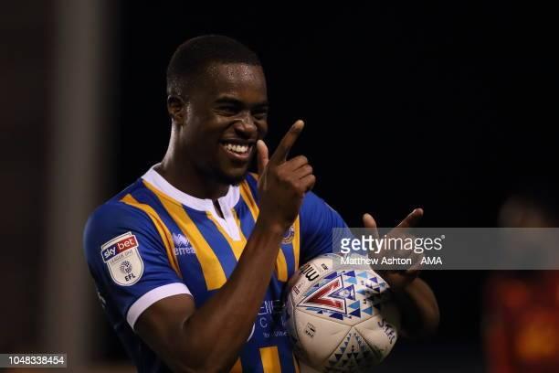 Fejiri Okenabirhie of Shrewsbury Town walks off with the match ball after scoring a hat trick during the EFL Checkatrade Trophy match between...