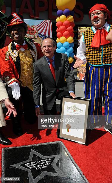 Feld Entertainment CEO Kenneth Feld along with unidentified circus performers pose outside Staples Center at a dedication ceremony to unveil a star...