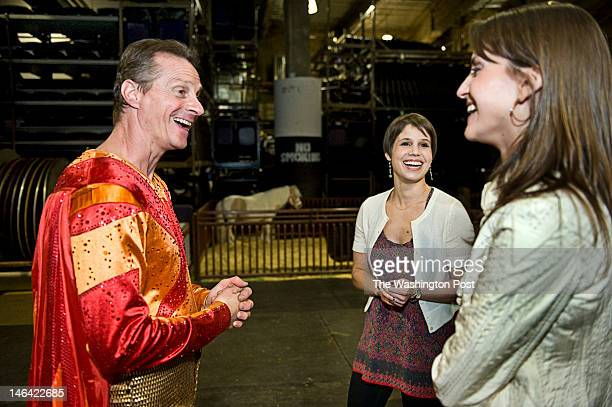Feld sisters Nicole middle and Alana right talk with human cannonball Brian Miser left known as the Human Fuse backstage at the Ringling Bros and...