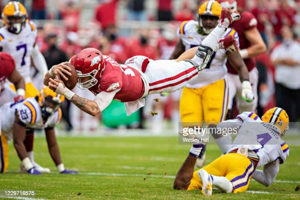 Feleipe Franks of the Arkansas Razorbacks dives into the end zone for a touchdown in the first half of a game against the LSU Tigers at Razorback...