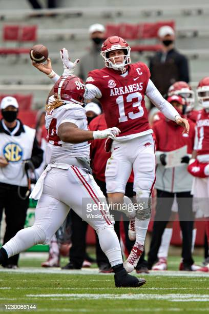 Feleipe Franks of the Arkansas Razorbacks throws a pass on the run in the first half of a game against the Alabama Crimson Tide at Razorback Stadium...