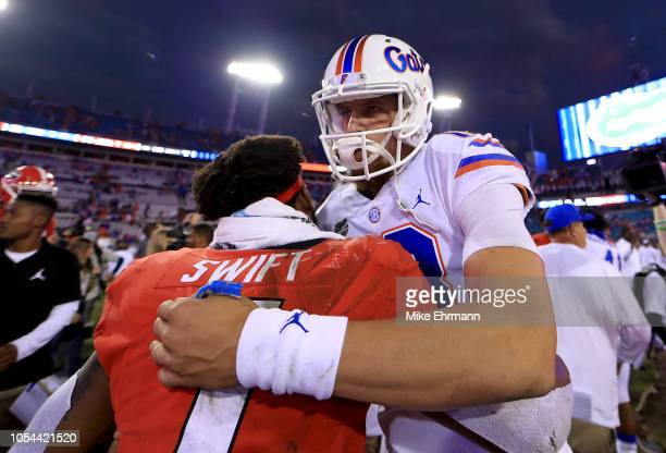 Feleipe Franks of the Florida Gators and D'Andre Swift of the Georgia Bulldogs shake hands following a game at TIAA Bank Field on October 27 2018 in...