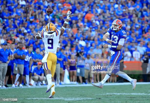 Feleipe Franks of the Florida Gators attempts a pass over Grant Delpit of the LSU Tigers at Ben Hill Griffin Stadium on October 6 2018 in Gainesville...