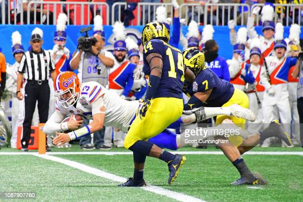 Feleipe Franks of the Florida Gators dives for a second quarter touchdown against the Michigan Wolverines during the ChickfilA Peach Bowl at...