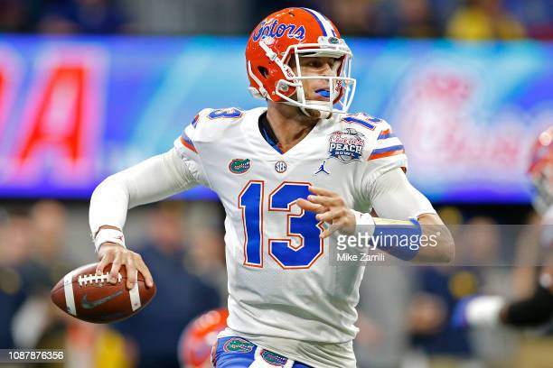 Feleipe Franks of the Florida Gators looks to pass against the Michigan Wolverines in the first quarter during the ChickfilA Peach Bowl at...