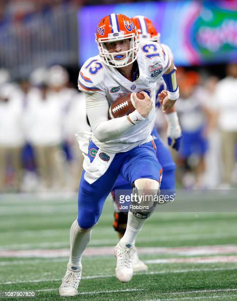 Feleipe Franks of the Florida Gators runs for a second quarter touchdown against the Michigan Wolverines during the ChickfilA Peach Bowl at...