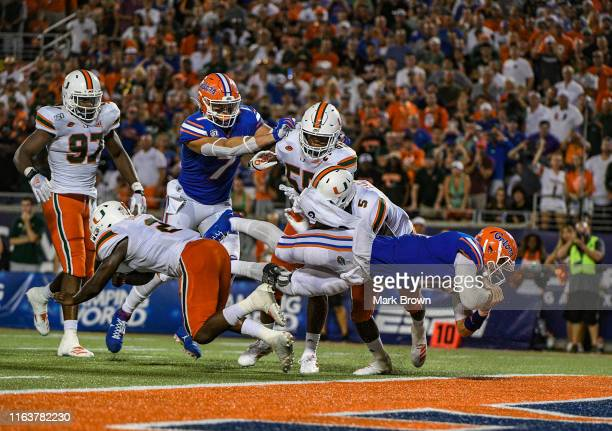 Feleipe Franks of the Florida Gators scores the go ahead touchdown in the second half against the Miami Hurricanes in the Camping World Kickoff at...