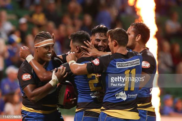 Feleti Kaitu'u of the Force celebrates with team mates after crossing for a try during the Rapid Rugby match between the Western Force and the Asia...