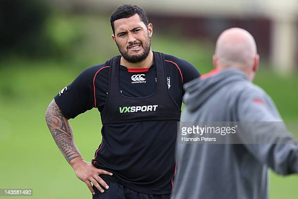 Feleti Mateo listens to head coach Brian McClennan during a New Zealand Warriors NRL training session at Otahuhu College on April 30 2012 in Auckland...