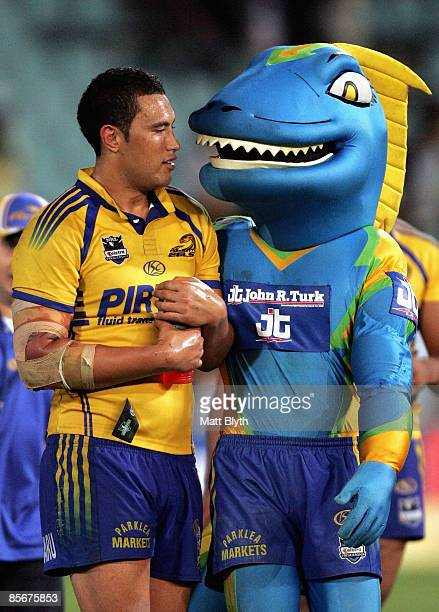 Feleti Mateo of the Eels is congratulated by the Eels mascot 'Sparky' after the round three NRL match between the Parramatta Eels and the Canberra...