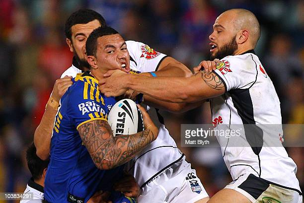 Feleti Mateo of the Eels is tackled during the round 26 NRL match between the Parramatta Eels and the Warriors at Parramatta Stadium on September 4...