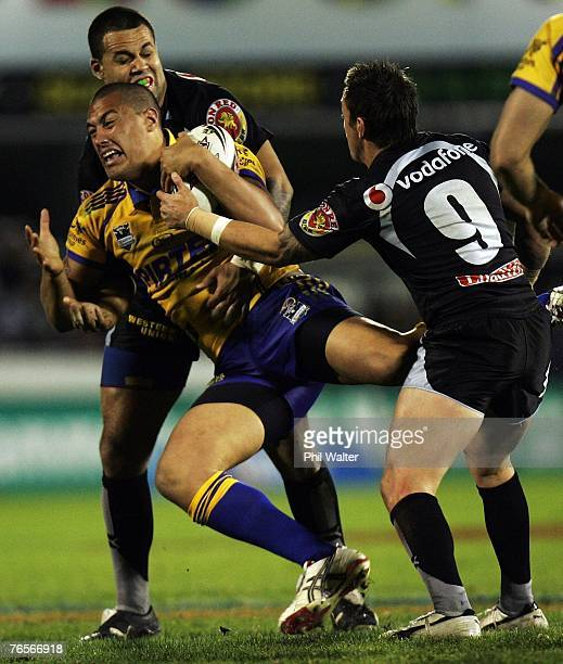 Feleti Mateo of the Parramatta Eels is tackled by Louis Anderson and Nathan Fien of the Warriors during the NRL qualifying final match between the...