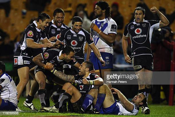 Feleti Mateo of the Warriors celebrates after scoring a try during the round 19 NRL match between the Warriors and the Canterbury Bulldogs at Mt...