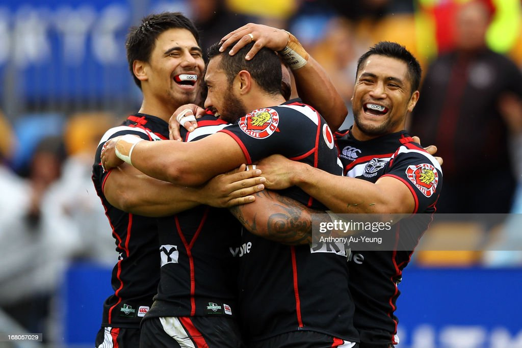 Feleti Mateo of the Warriors is mobbed by teammates Ben Henry and Jerome Ropati after his try during the round eight NRL match between the New Zealand Warriors and the Gold Coast Titans at Mt Smart Stadium on May 5, 2013 in Auckland, New Zealand.