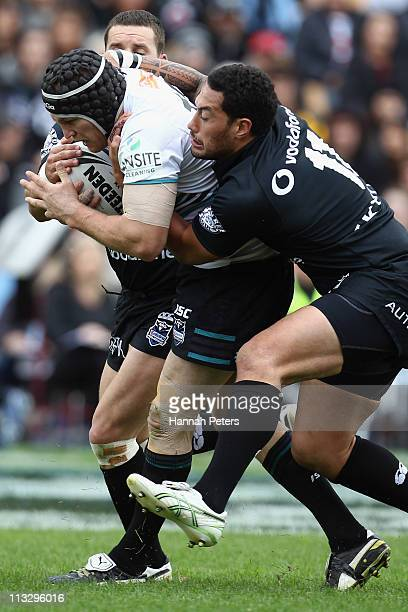 Feleti Mateo of the Warriors tackles Nigel Plum of the Panthers during the round eight NRL match between the Warriors and the Penrith Panthers at Mt...